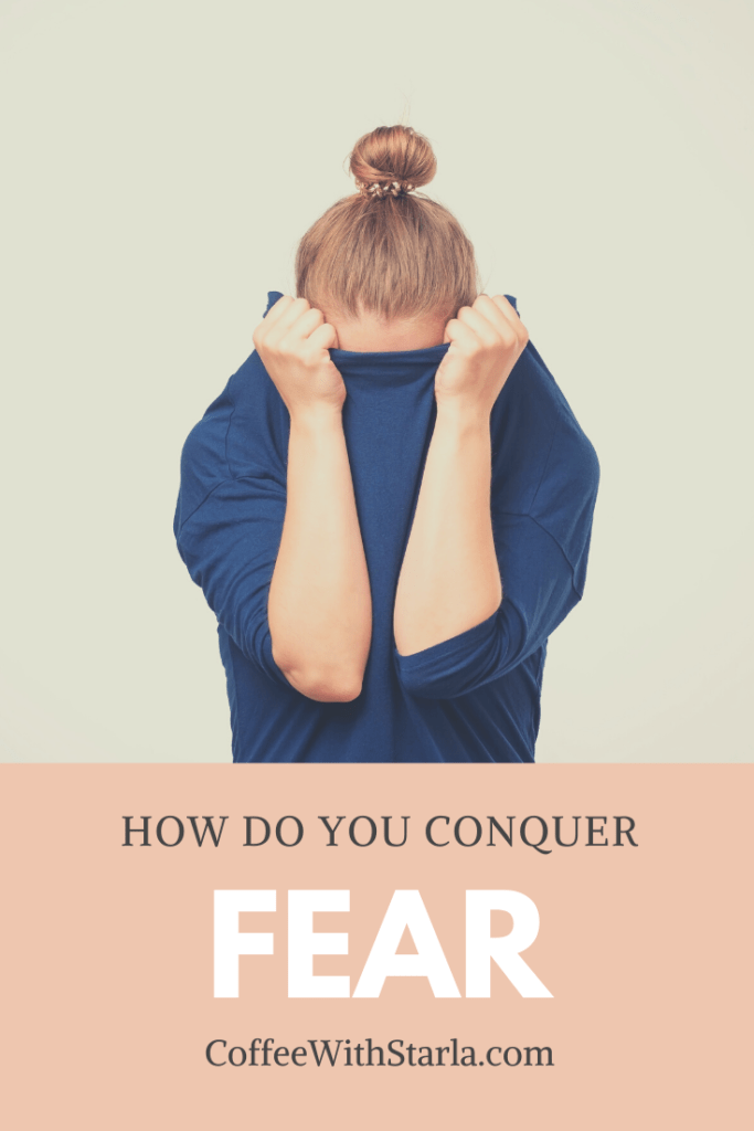 How do you conquer fear, woman with blue shirt over head and her bun and top of head is sticking out